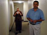 (DENVER, COLO., MAY 6, 2004)  Thamara Mahmood al Saloum follows her son, Kazwan Mahmoud Elias,...