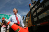 MJM241   Governor Bill Owens picks up an orange construction cone to ceremonially open Downing...