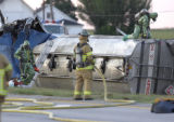 LOVELAND, COLO., PHOTO TAKEN JUNE 21, 2004- Loveland and Poudre HAZMAT workers clean up the...