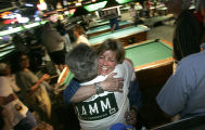 Peggy Lamm (cq) is hugged by supporters when she arrived at Table Steaks for her election night...