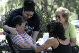 Lucy Gonzales (cq) great-grandmother of Deion Santistevan , gets a hug from family member Tina...