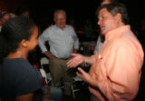 Chris Romer talks with Helen Abiso and his father former Gov. Roy Romer moments after receiving a...