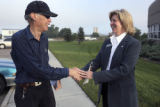 L to R: Voter Elmer Blucher (cq) , 77, gets greeted by Peggy Lamm (cq)  at the Commerce City Motor...