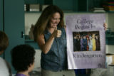 Kindergarten teacher Michelle Lang (cq) as she sets up her room she finds a poster saying 'College...