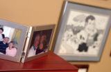 KAS110 Real estate broker Jack Kennedy's favorite things in his office are pictures of his family,...