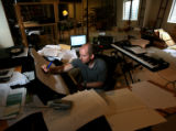 Composer Daniel Kellogg (cq) works on a musical piece from his home, 3085 Stevens Circle North,...