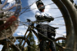 Rocky Mountain Adventure.  Seen through the wheel spokes of a friend's bike, Curtis Cole, of...