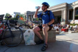 (DENVER, Colo., June 23, 2004) Scott Windberg, of Arvada, rehydrates at Civic Center Park after...