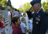 (DENVER, Colo., June 23, 2004)  Major General Mason C. Whitney (rt.) gives Anthony Morado, 8,...