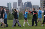 "(DENVER, Colo., July 1, 2004)   Two kickball teams ""high-five"" each other after a..."