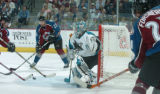 (Denver, Colo., April 26, 2004)  San Jose Sharks' goalie, Evgeni Nabokov makes an adjustment as...