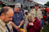 06/05/2004 Hampton, Virginia-Members of a Boy Scout troop bow their heads in a moment of silence...