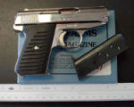 NYT42 - (NYT42) UNDATED -- June 29, 2004 -- GUN-SALE-2 -- A .380 caliber Bryco Arms gun. The...
