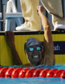 (NOTE: 1/2 frame enlargement, size with caution.) Natalie Coughlin reacts to her victory in the...