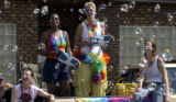 (DENVER, CO., June 27, 2004)  Spectators are showered with bubbles from one of the floats taking...