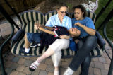 (DENVER, Colo., May 6, 2004)  Tammi Rawlins (center) of Aurora plays with her son Tyler, 7, and...