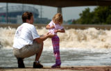 (DENVER, CO.,  Shot June 28, 2004)  In the wake of heavy rains Sunday, water flow on the South...