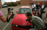 members of the media photograph Boulder Public Defender Seth Temin (cq), center, as he leaves the...