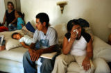 (DENVER, Colo., July 12, 2004) (Foreground Rt. to Lt.) The Salazar family mother Fabiola Romero,...