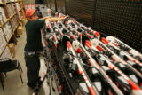 MJM597 Running out of room in the main showroom, Chris Harris (cq), 21, stacks skis in a back...