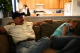 ***HIGH COUNTRY ENTERPRISE***Joe Ferand(cq), left, and daughter Corey, 15, sit in their livingroom...
