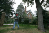 Freelance cameraman Dave Westin (cq), of Golden, films the front of the home in Boulder on August...
