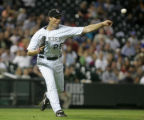 Rockies starting pitcher Jeff Francis makes a throw to first for a out in the top of the third...
