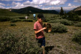 At the top of Guenella Pass, Arlin Bloch (cq) 9 of Longmont looks for mushrooms along with the...