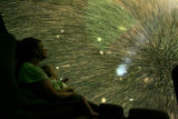 At the Museum of Nature and Science's Planetarium exhibit, Robin Gabel (cq) holds her 12 month old...