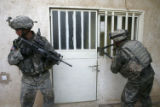 (NYT30) BAGHDAD, Iraq -- Aug. 12, 2006 -- IRAQ -- U.S. Army 172nd Stryker Brigade soldiers break a...