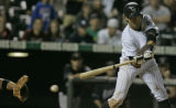 Colorado Rockies' batter Ryan Spilborghs swings as he strikes out to hand the Arizona Diamondbacks...