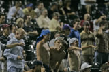 Colorado Rockies' fans watch in disappointment as pitcher Ramon Ramirez gave up what would become...