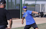 SPECIAL TO ROCKY MOUNTAIN NEWS--CODER--KC Royals pitching coach Mike Mason watches Luke Hochevar...
