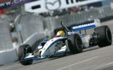 Jan Heylen rounds turn 1 during a Champ Car practice round for the on the first day of the Grand...