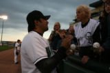 Vinny Castilla gets ready to sign a autograph for a Colorado Rockies fan as her makes a return to...
