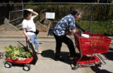 (DENVER, Colo., May 7, 2004)  Laura Cher (left) of Englewood and Paul Schmidt of Denver wait in...