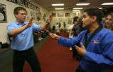 DLM01140 Leigh Ollerenshaw, 22, takes a non-threatening defensive posture as instructor Ranulfo...