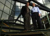 (ENGLEWOOD, Colo., July 8, 2004)  David Naus and John O'Meara (lt.-rt.) stand on a scaffold...