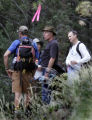Lloyd Hering (cq) , (wearing fedora) third from left, searches with rescue workers and friends...