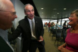 DLM03125    Gubernatorial candidate Sen. Bob Beauprez, center, shares a laugh with Ron Smith,...