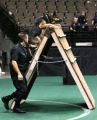 Commerce City Police officer Mark Douglas (cq) puts his dog Cezar through the agility course...
