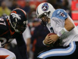 08/19/2006 Denver Broncos Demetrin Veal, #97, zeroes in for a sack of Tennessee Titans quarterback...