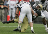 Colorado Buffaloe tail back, Hugh Charles, right,  is stopped by Montana State Defender Terry...