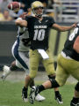 Starting quarterback for the Colorado Buffaloes, James Cox, can't get the ball off in time as...