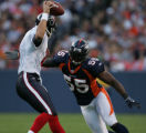 JPM073 Denver Broncos D.J. Williams, #55, zeroes in on Houston Texans quarterback David Carr...