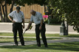 Greeley crime scene investigators (would not give their names) scan the area for shell casings at...