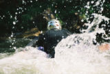 Matt Young prepares to launch into a rapid and surfs in a rapid on Clear Creek near Lawson,...