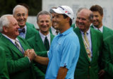 Dean Wilson (center) gets a hearty congratulations from Castle Pines club member Bones Slifer...