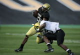 Wide receiver Alvin Barnett gets taken down by Terry Washington at a CU football team scrimmage...