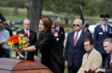DLM00151   Danna Barnes, front left, of Seattle, Wash. places flowers on the casket of her father...